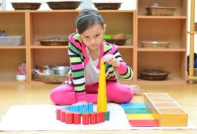 a girl playing with blocks