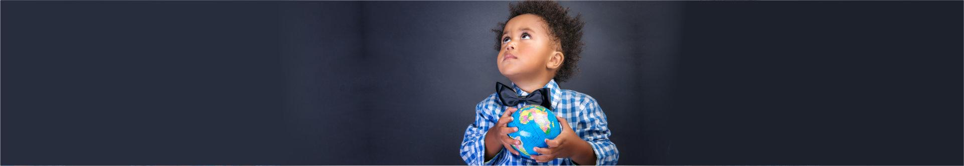 child carrying globe